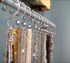 Shower curtain hooks for jewelry, belts, scarves. #organizedhome