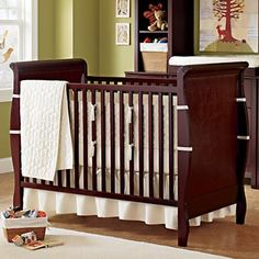 http://www.landofnod.com/baby-cribs/kids-furniture/espresso-sleigh-crib/f4443  Love the dark wood