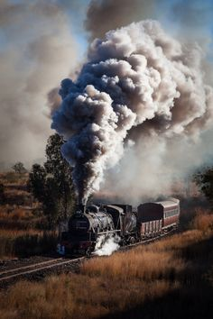 Steam locomotive and carriages thundering through a pass on the way to Cullinan - South Africa