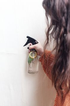 Fill a spray bottle with distilled water, and pop in some plants like sage, rosemary, lemon balm, and lavender. Let sit for a few hours, then mist in the air to create a beautiful, fresh aroma in every room! This spray should stay fresh for at least a few days — store in the refrigerator for maximum freshness.""
