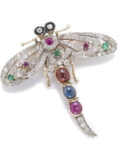 A gem-set, synthetic ruby, enamel and diamond dragonfly brooch composed of: ruby, emerald, garnet and sapphire; estimated total diamond weight: 2.00 carats; mounted in fourteen karat bicolor gold; length: 2 1/4in. (loss to enamel)