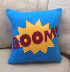 Superhero pillow by Out of the Box.  www.outoftheboxshop.com