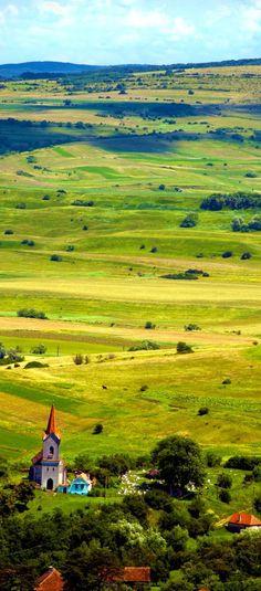 Beautiful Plateau Landscape and Village with Church in Transylvania Romania - Hasag Discover Amazing Romania through 44 Spectacular Photos Beautiful Places To Visit, Wonderful Places, Beautiful World, Great Places, Places Around The World, Around The Worlds, Places To Travel, Places To Go, Transylvania Romania