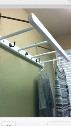 Use A ladder As A Laundry Room Drying Rack...make it if you can't buy it.....hang it from ceiling, rather than wall mount.