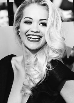 Rita Ora looks absolutely STUNNING.. with her hair like that and her makeup.. everything ...this look is glamorous!