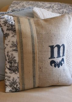 burlap pillow idea...like the monogram idea & ribbon...use different pillow fabric on the end