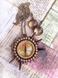 Bead embroidered Gold Dragon-Eye Pendant & от TheKingsJewellery