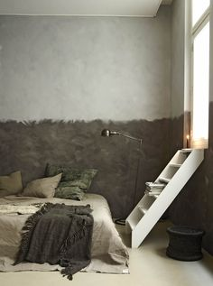 Bed on the floor with neutral tones.
