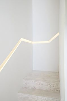 Banish the banister. This couple cut into the wall and illuminated a railing-like space with LEDs.