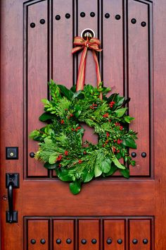 Mixing common lemon leaves, available year round, with seasonal greens like huckleberry, incense cedar and boxwood creates a textured look that's just right for this time of year. Bright red Ilex berries add just the right pinch of color.