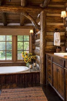 Nice big log cabin bathroom. Must have 2sinks -separate shower and tub.. Loo or toilet private-nice lighting.. And candles...