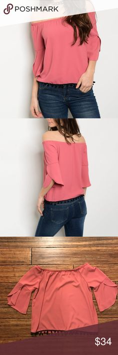 """Blush Off-the-shoulder Top Pretty off-the-shoulder top in blush - a trending color for the season. 3/4 bell sleeves with slit and mini black Pom Pom design at hem. Approx. 20"""" long, 19"""" armpit to armpit, 16.5"""" across top, and 19.5"""" across waist. Sleeves approx. 9"""" long. 98% polyester, 2% spandex. Tops Blouses"""