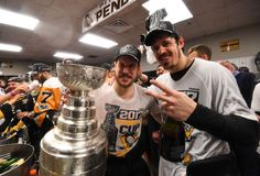 Penguins Mobile: NASHVILLE, TN - JUNE 11:  Captain Sidney Crosby #87 and Evgeni Malkin #71 of the Pittsburgh Penguins pose for a photo with the Stanley Cup in the locker room after Game Six of the 2017 NHL Stanley Cup Final at the Bridgestone Arena on June 11, 2017 in Nashville, Tennessee. The Penguins defeated the Predators 2-0. The Pittsburgh Penguins win the Stanley Cup Final series against the Nashville Predat