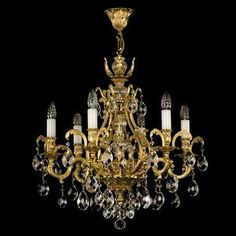 Beautiful brass chandeliers festooned with crystal pendants by ArtGlass #GoldChandelier #LuxuryLighting #BohemianCrystalChandelier