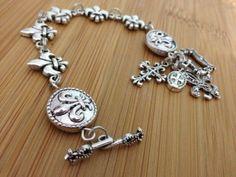 Fleur de lis bracelet silver metals and by FleurDeLisBowtique, $25.00
