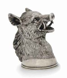 A SMALL RUSSIAN CAST SILVER STIRUP CUP MODELLED AS A BOAR'S HEAD -   MARK OF SAMUEL ARND, ST. PETERSBURG, 1856, WITH LATER FRENCH CONTROL MARK -   Gilt interior,  3 in. high (7.5 cm.)  6 oz. (186 gm.)