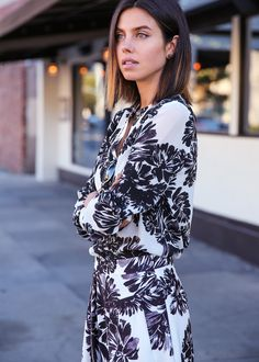 Spring / Summer - street chic style - beach style - casual style - black and white bold floral print set (with culottes and long sleeve v-neck top) + black sunglasses + black crossbody bag