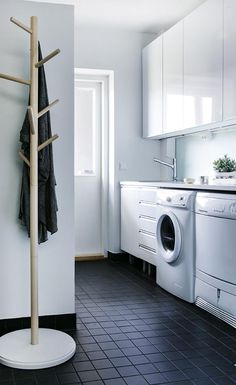 In love with the crisp white room and dark tile. Small Laundry Rooms, Laundry In Bathroom, Bathroom Toilets, Bathrooms, Paint Colors For Living Room, Small Room Bedroom, Laundry Room Design, Bathroom Inspiration, Living Room Designs