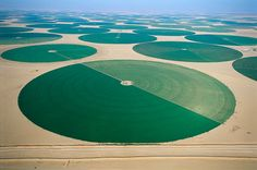 An aerial view of circle pivot irrigation, fed by wells pumping fossil water from aquifer in As-Sulayyil, Saudi Arabia