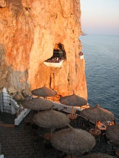 The Cueva D'en Xoroi in Menorca, Spain has probably the most unbeatable location of any bar we've ever seen. Feel like a cocktail with the sunset over the Mediterranean? http://www.minube.net/place/cave-d-in-xoroi--a389851