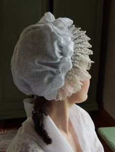 Mob Cap- a large soft hat covering all of the hair and typically having a decorative frill, worn indoors by women in the 18th and early 19th centuries.