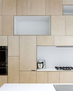 Light wooden tetris kitchen cupboards. Gas stove. t&s : m architecture & V.O.