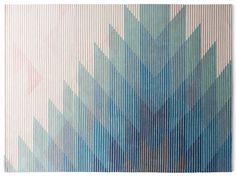 Handmade rug with optical pattern LAKE BLUE by Golran design Raw Edges