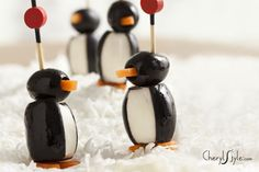 Made with three simple ingredients: black #olives, carrots and cream cheese—these charming #Penguin Popper #Appetizers will march right off your serving tray! www.CherylStyle.com