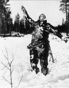 The corpse of a Russian soldier stands rigid in a clearing during the Winter War. This scare tactic was used by Finnish troops to intimidate Russians invaders as they advanced through hellish winter conditions. Finland, December 1939.