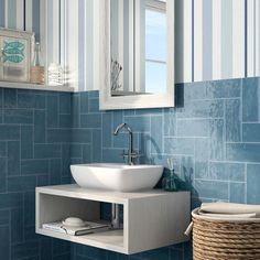 White subway tiles are a classic choice for any design style. But have you considered shaking up your design with a handcrafted look or beveled tiles? Check out our idea book for subway tile inspiration! Tile Layout Patterns, Geometric Patterns, Tiles Uk, Blue Tiles, Paredes Color Aqua, White Bathroom, Small Bathroom, Bathroom Mirrors, Aqua Walls
