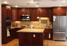 Traditional Kitchen with dark cherry wood kitchen cabinets