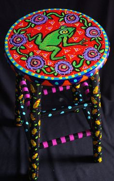 hand painted bar stool with a happy colorful frog