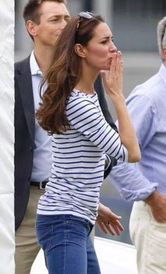 Giving flying kisses away to her husband