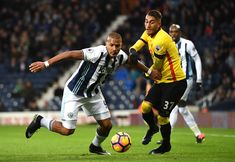Jose Salomon Rondon of West Bromwich Albion and Roberto Pereyra of Watford compete for the ball during the Premier League match between West Bromwich Albion and Watford at The Hawthorns on December 3, 2016 in West Bromwich, England.