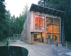 Now, I wouldn't want to clean these windows, but the light must be amazing. http://coolboom.net/tag/cabin/