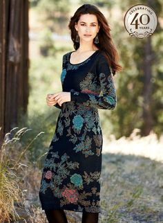 Cast in opulent jewel tones, strategically placed chrysanthemums stand out against a dramatic black ground. Breathtakingly beautiful, the sultry sheath is jacquard knit of pure pima, with a scoop neck and full-length sleeves.