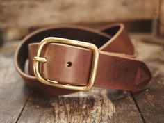 Gold plated center bar buckle on a leather belt, old is gold.
