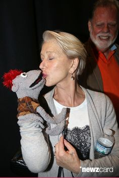 Helen Mirren and 'Tyrone' (the demonic puppet) pose backstage at the hit play 'Hand of God' on Broadway at The Booth Theater on June 10, 2015 in New York City. (Photo by Bruce Glikas/FilmMagic)