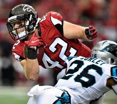 Panthers Falcons Football Atlanta Falcons fullback Patrick DiMarco (42) runs against Carolina Panthers cornerback Daryl Worley (26) during the first half of an NFL football game, Sunday, Oct. 2, 2016, in Atlanta. (AP Photo/Rainier Ehrhardt)