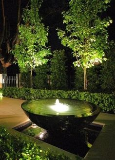 Cool lighted water feature with an infinity-edge. www.ContainerWaterGardens.net