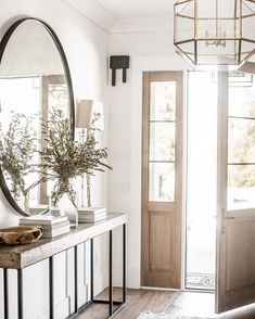 Modern Farmhouse Entry Styling – Entrance style in a modern farmhouse – Here is some information about modern lifestone and wood are a must for modern rustic spacesRustic floral decoration in a shabby chic style Large Round Mirror, Round Mirrors, Circular Mirror, Large Mirror Decor, Home Decor Mirrors, Home Design Decor, Interior Design Living Room, Design Ideas, Interior Door