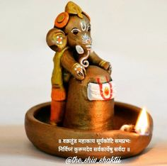 Get this unique terracotta copper finish baby Ganesha holding Lord Shiva in pound. The Ganesha and the Lord Shiva Idol has been handpainted with multiple colours to give it a class and sheen. Clay Ganesha, Shri Ganesh, Ganesha Art, Lord Ganesha, Hanuman, Krishna Krishna, Ganesh Images, Ganesha Pictures, Ganapati Decoration