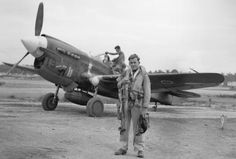 Geoff B. Fisken flew a US-built Curtiss P-40 Kittyhawk during the Solomon Islands campaign in June 1943. Note black cat on fuselage. (Royal New Zealand Air Force Museum)