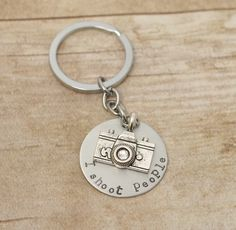 Hand stamped Photography keychain - Great for photographers - I shoot people. $15.00, via Etsy.