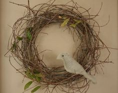 Bird wreath... add a touch of Silver ribbon and a few small silver bulds and Voila. Holiday time. then transition it back to all an all season look if you'd like.