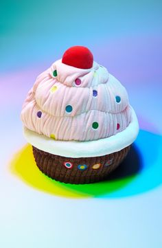 Won't have to worry about getting crumbs in the bed with this fun cupcake pillow.