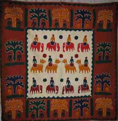 Elephants and Trees wall hanging. This is from India and is hand stitched. Borders are rust with colored  trees in gold, green and dark blue. Center is ecru with gold, red and  burgundy elephants.    Content and size:  37x37 inches, cotton $52.25
