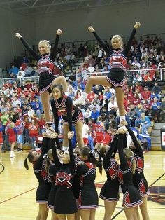 I like this stunt one side 8 girls, shoulder sit in middle pop up to this postition. Cool Cheer Stunts, Cheerleading Workouts, School Cheerleading, Cheerleading Pictures, Cheer Pictures, Cheerleading Poses, Squad Pictures, Volleyball Pictures, Softball Pictures