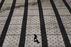 Wanderer  - An ultra-Orthodox Jewish man walks in the courtyard of the Belz yeshiva in Jerusalem