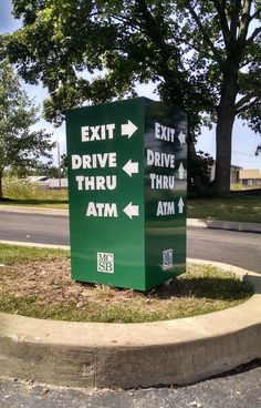 monolithic aluminum directional sign finished with digtially-printed vinyl graphics and reflective vinyl lettering